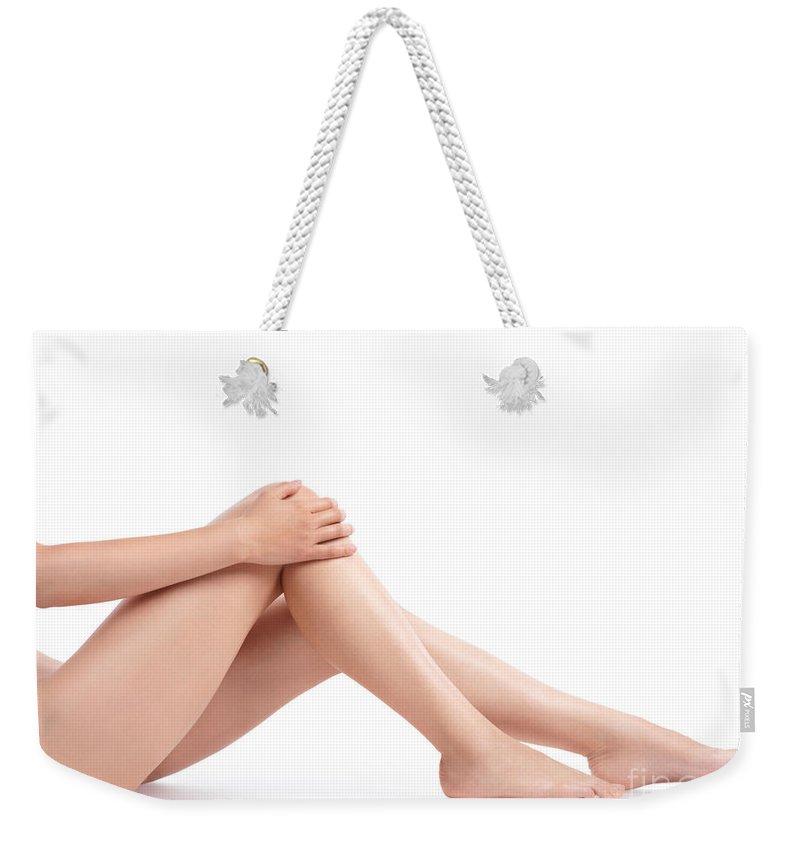Legs Weekender Tote Bag featuring the photograph Bare Woman Legs by Oleksiy Maksymenko