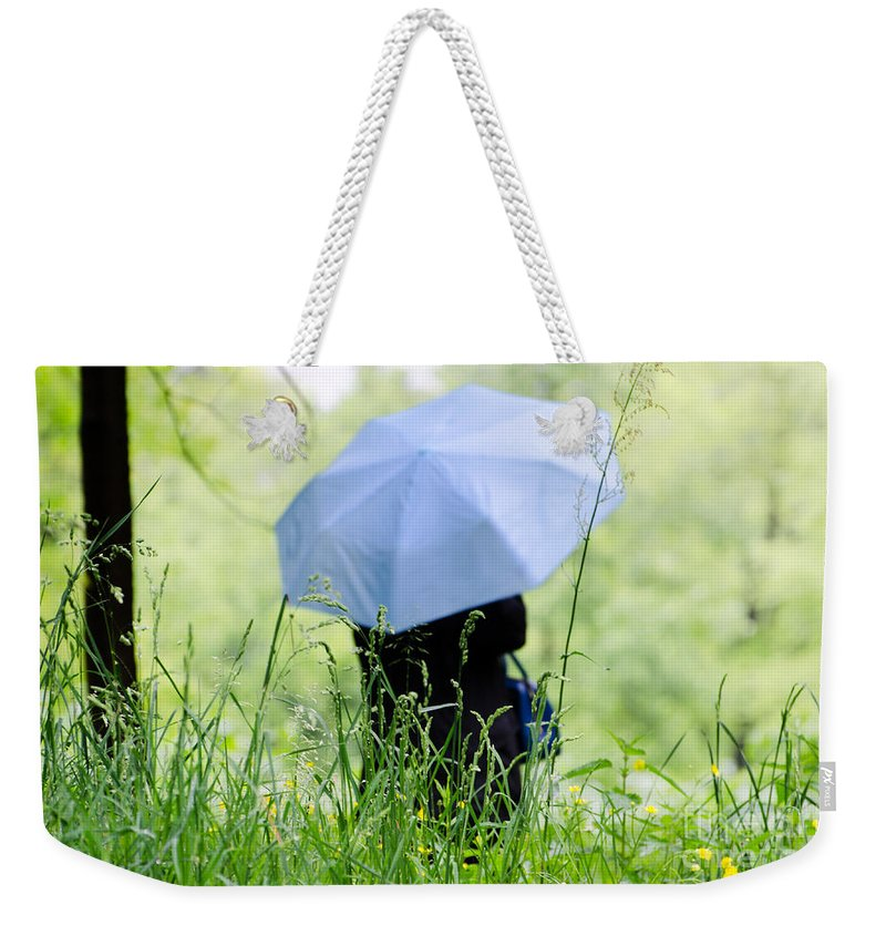 Woman Weekender Tote Bag featuring the photograph Blue Umbrella by Mats Silvan