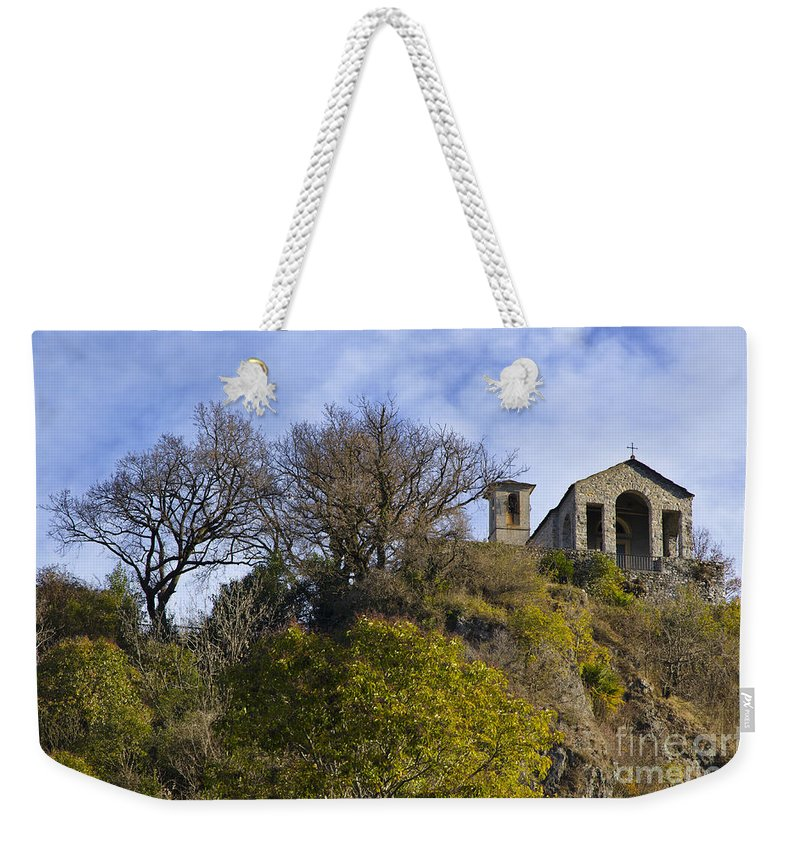 Church Weekender Tote Bag featuring the photograph Church On A Hill by Mats Silvan