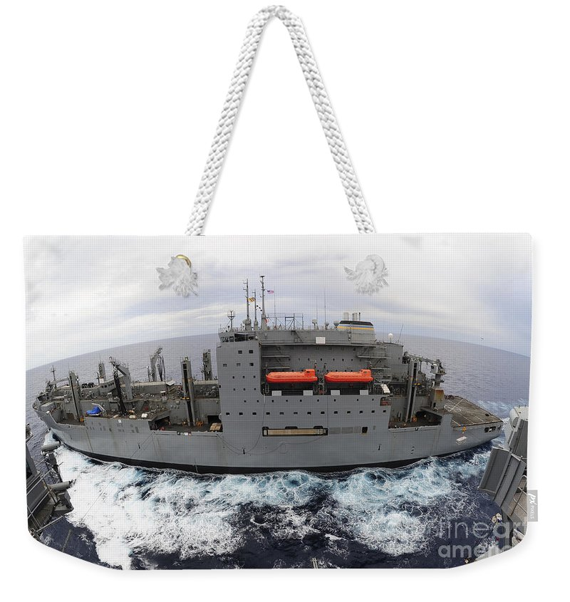 Military Weekender Tote Bag featuring the photograph Dry Cargo And Ammunition Ship Usns by Stocktrek Images