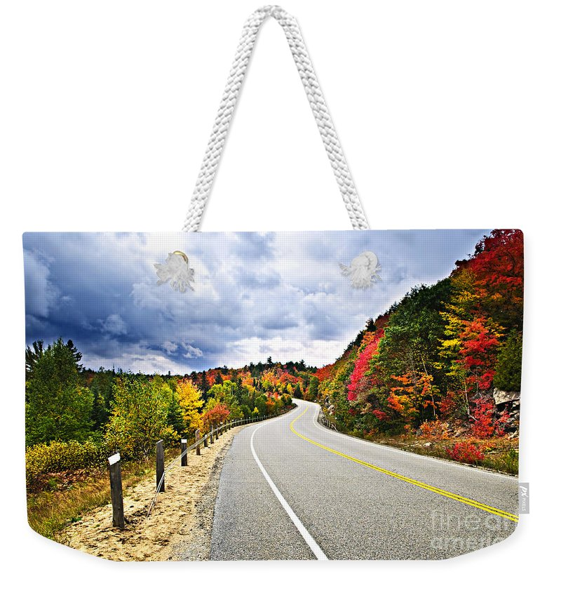 Road Weekender Tote Bag featuring the photograph Fall Highway by Elena Elisseeva