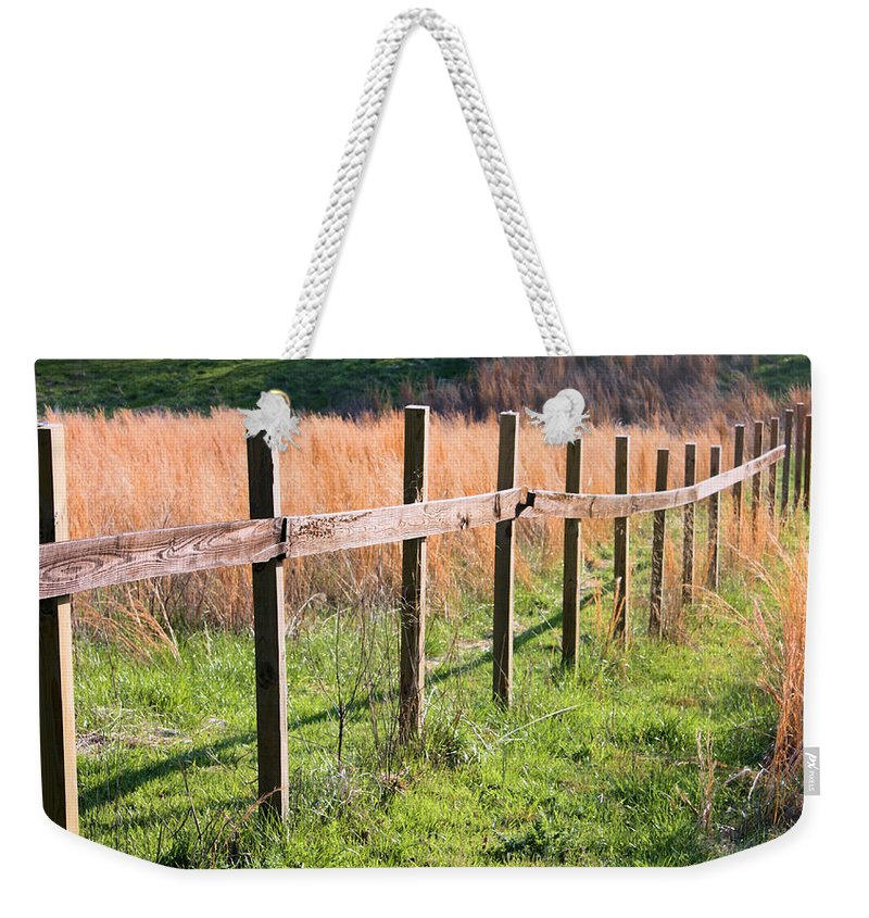 Fence Weekender Tote Bag featuring the photograph Fence Perspective by Kristin Elmquist