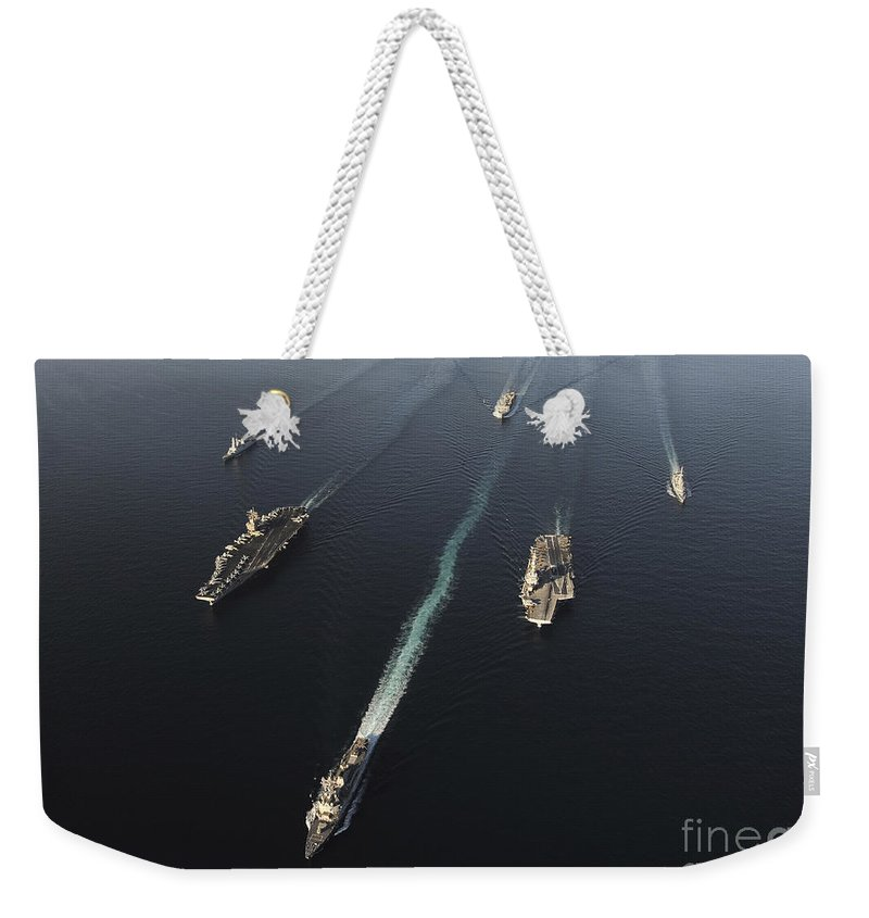 Horizontal Weekender Tote Bag featuring the photograph Fleet Of Navy Ships Transit The Arabian by Stocktrek Images