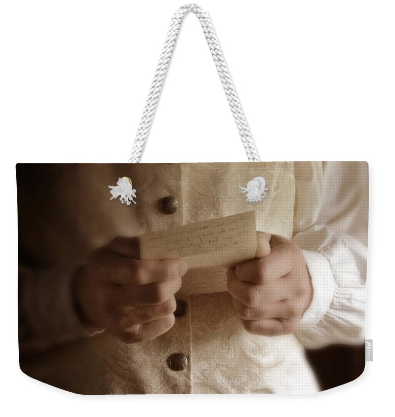 Gentleman Weekender Tote Bag featuring the photograph Gentleman In Vintage Clothing Reading A Letter by Jill Battaglia