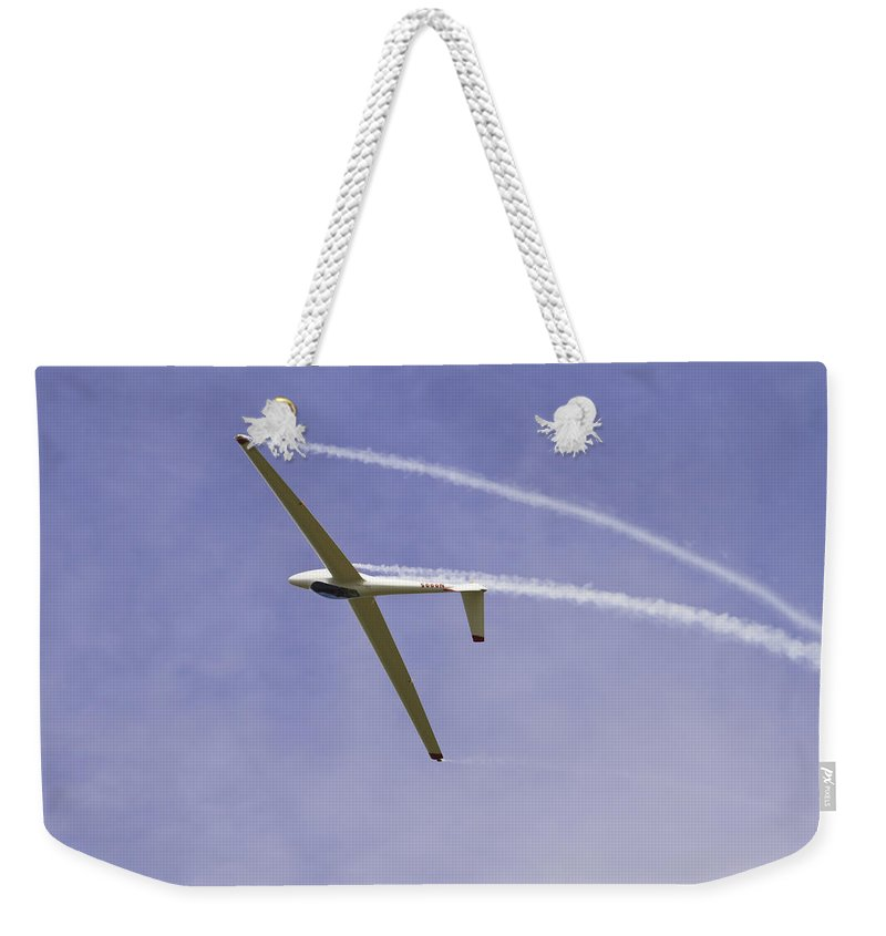 Plane Weekender Tote Bag featuring the photograph Glider Flying Aerobatics At Airshow Canvas Photo Poster Print by Keith Webber Jr