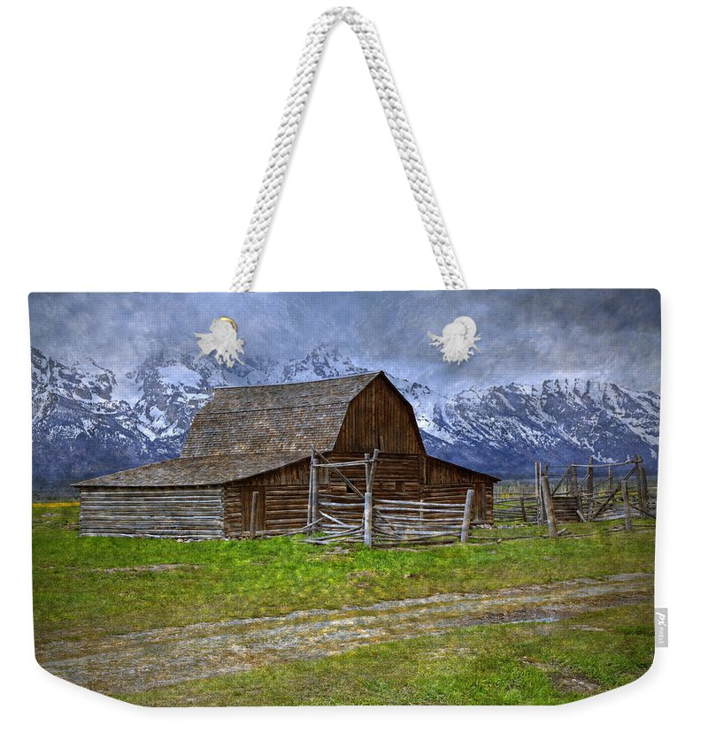 Cloudscape Weekender Tote Bag featuring the photograph Grand Teton Iconic Mormon Barn Fence Spring Storm Clouds by John Stephens