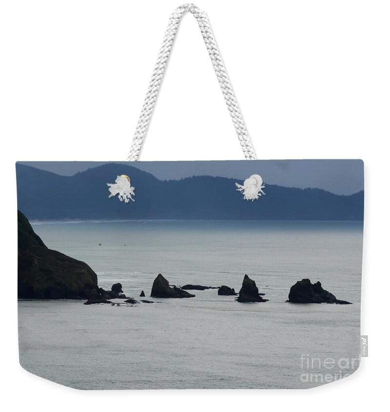 Window Rocks Weekender Tote Bag featuring the photograph Haystack Rocks by Bob Christopher