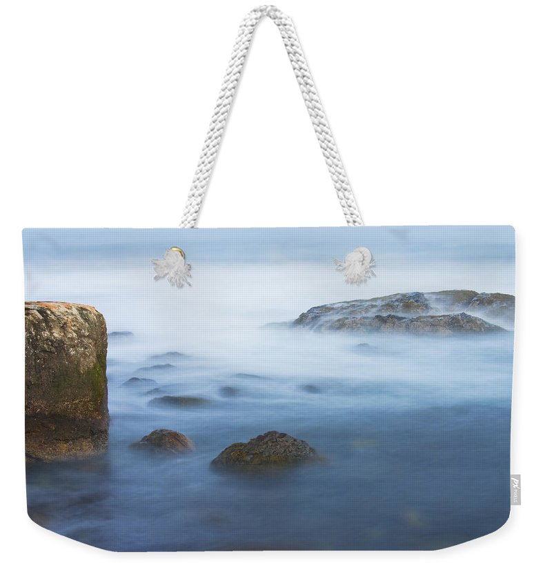 Maine Weekender Tote Bag featuring the photograph Long Exsposure Of Rocks And Waves At Sunset Maine by Keith Webber Jr