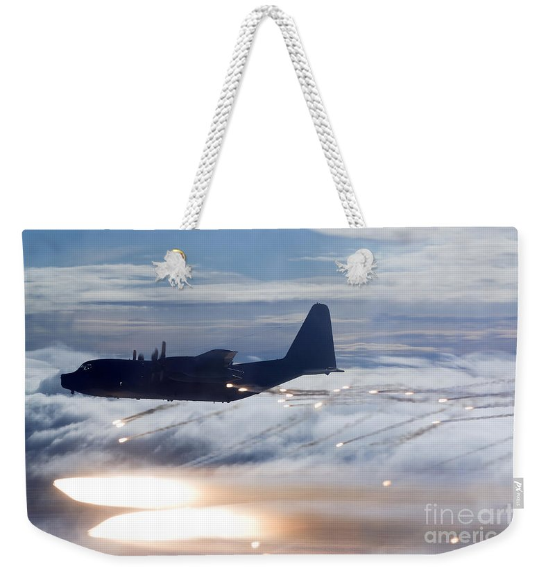 Mc-130 Weekender Tote Bag featuring the photograph Mc-130p Combat Shadow Dropping Flares by Gert Kromhout