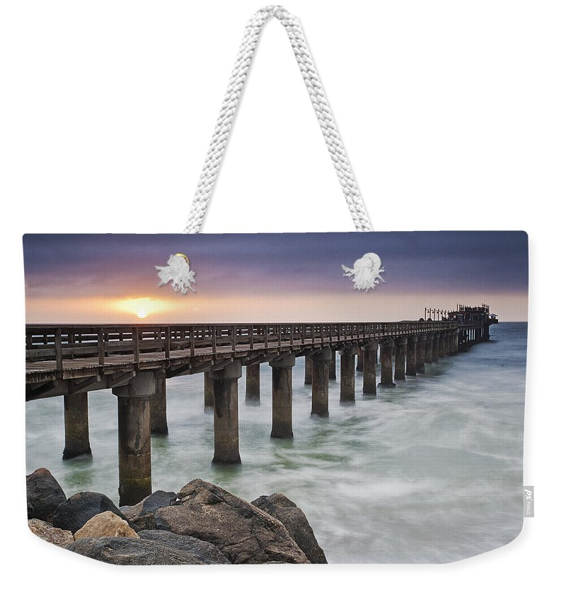 Swakopmund Weekender Tote Bag featuring the photograph Pier At Sunset by Fran Gallogly