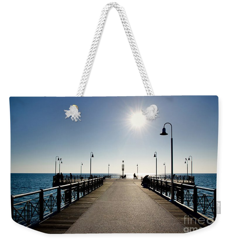 Pier Weekender Tote Bag featuring the photograph Pier In Backlight by Mats Silvan