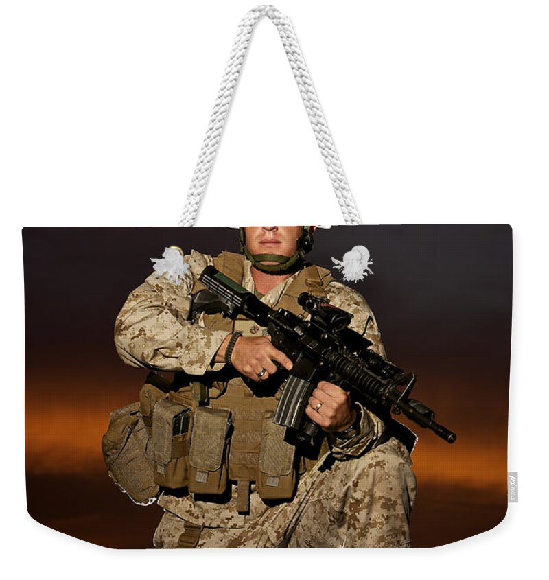 Afghanistan Weekender Tote Bag featuring the photograph Portrait Of A U.s. Marine In Uniform by Terry Moore