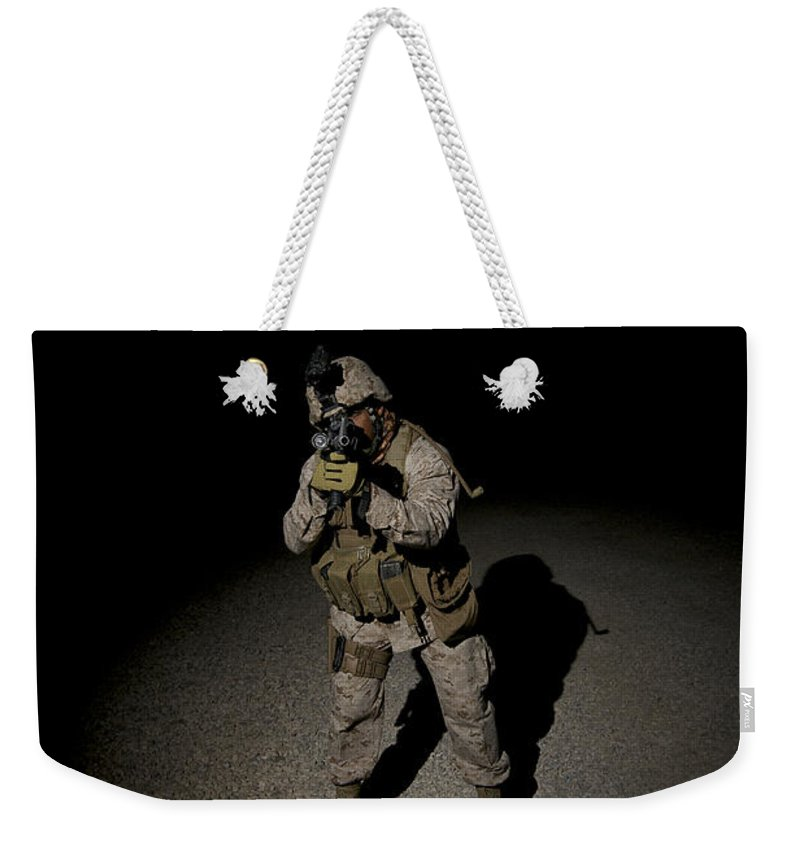 Operation Enduring Freedom Weekender Tote Bag featuring the photograph Portrait Of A U.s. Marine by Terry Moore