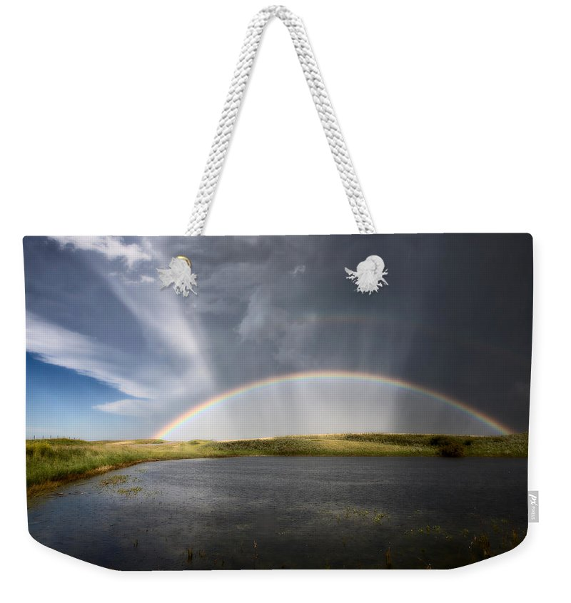Hail Weekender Tote Bag featuring the photograph Prairie Hail Storm And Rainbow by Mark Duffy