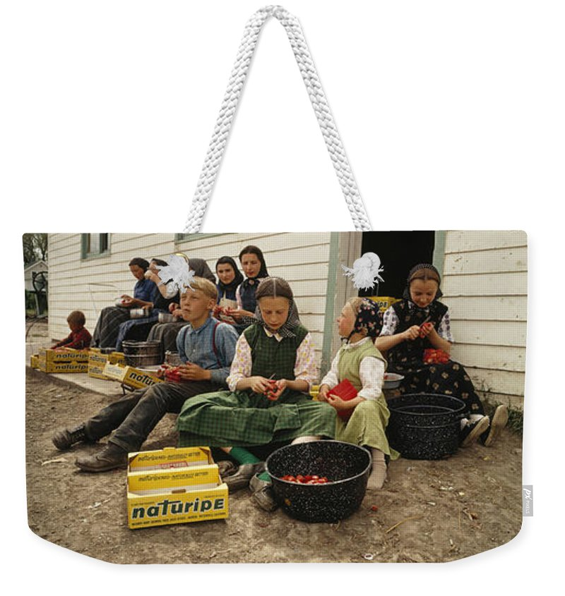 Weekender Tote Bag featuring the photograph retouched/Q.C by National Geographic