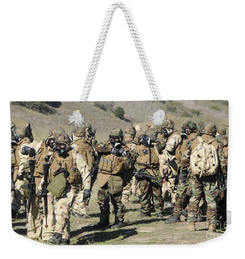 Training Weekender Tote Bag featuring the photograph Sailors Dressed In Full Mission by Stocktrek Images