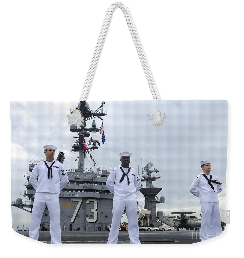 Uss George Washington Weekender Tote Bag featuring the photograph Sailors Man The Rails Aboard by Stocktrek Images