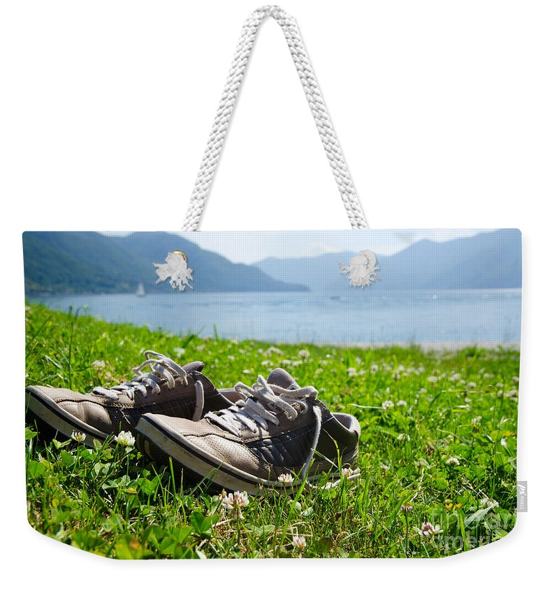 Shoes Weekender Tote Bag featuring the photograph Shoes On The Green Grass by Mats Silvan
