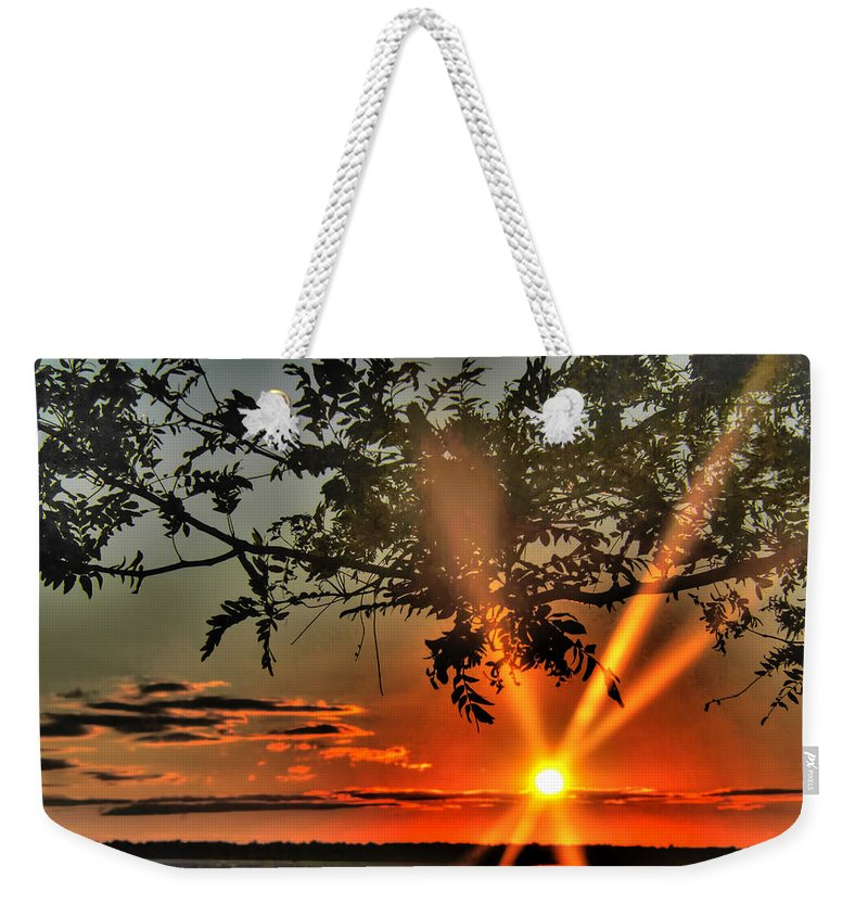 Weekender Tote Bag featuring the photograph Summers Breeze Sunsets Through Tress by Michael Frank Jr