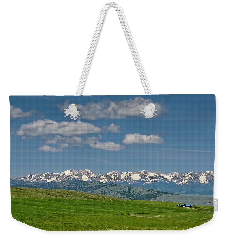 Americas Weekender Tote Bag featuring the photograph The Bridger Mountains by Roderick Bley