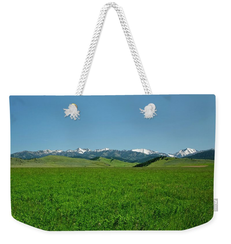 Americas Weekender Tote Bag featuring the photograph The Crazy Mountains by Roderick Bley