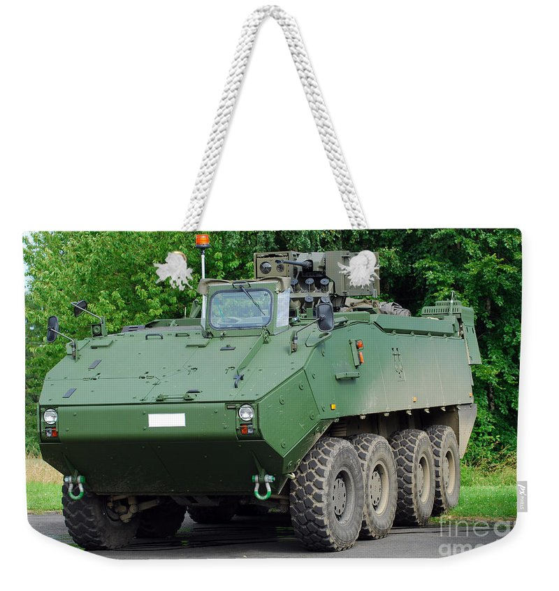 Armament Weekender Tote Bag featuring the photograph The Piranha IIic Of The Belgian Army by Luc De Jaeger