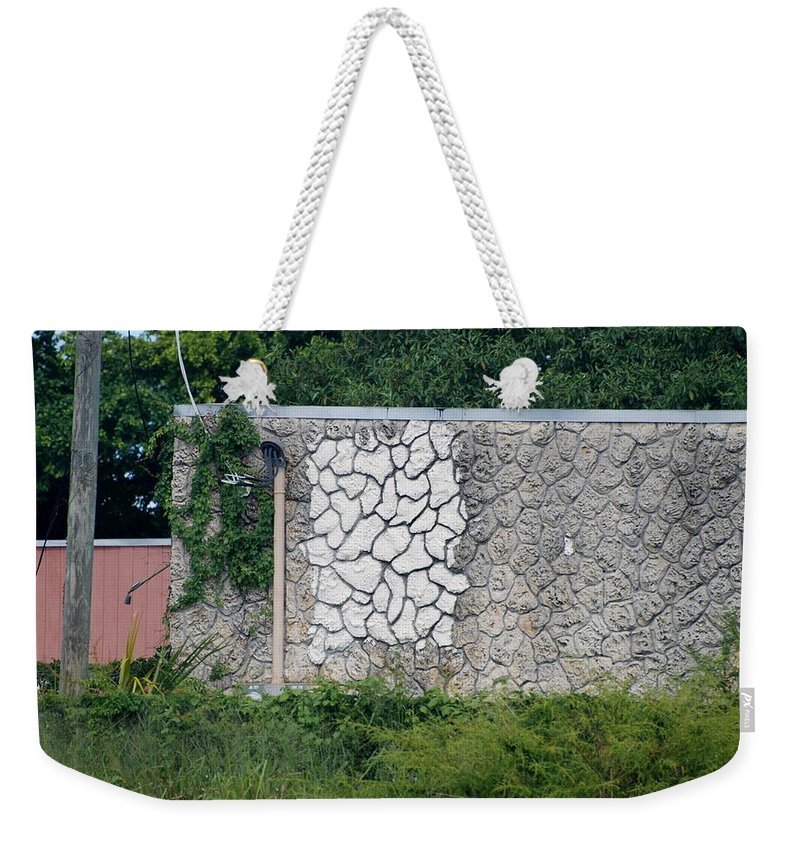 Grass Weekender Tote Bag featuring the photograph The Wall by Rob Hans