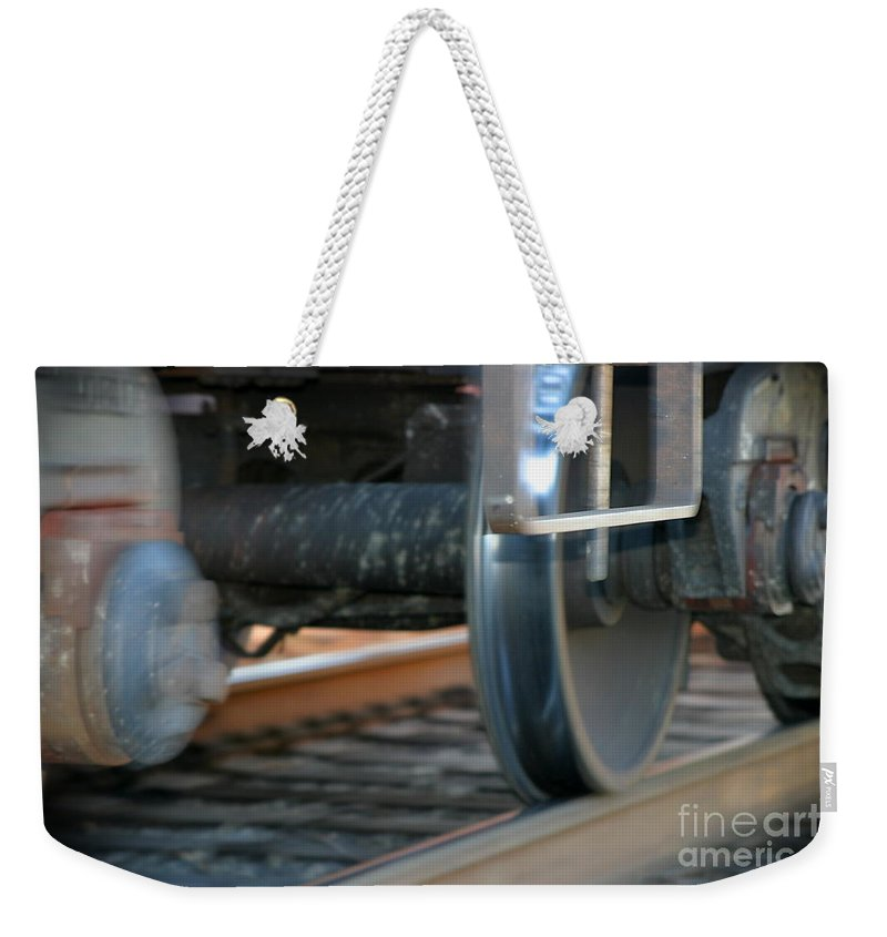 Tire Weekender Tote Bag featuring the photograph Train Tires by Henrik Lehnerer