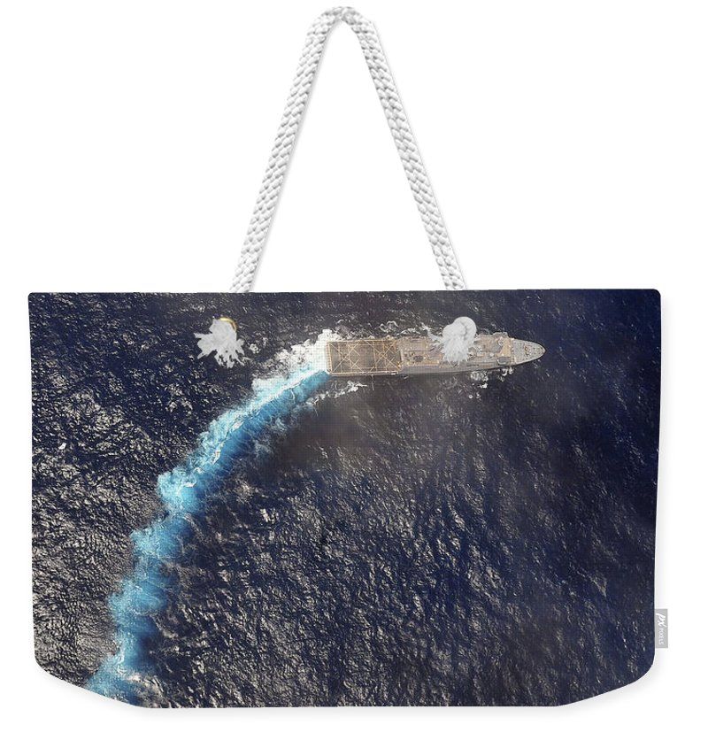 Navy Weekender Tote Bag featuring the photograph Uss Green Bay Transits The Indian Ocean by Stocktrek Images