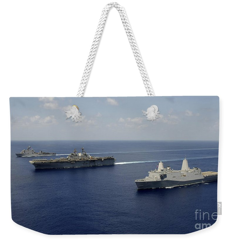 Military Weekender Tote Bag featuring the photograph Uss Pearl Harbor, Uss Makin Island by Stocktrek Images