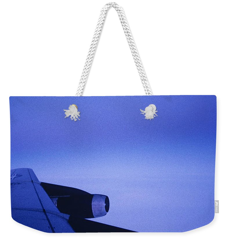 Northern Lights Weekender Tote Bag featuring the photograph View Out The Window Of A Boeing 707 by Kenneth Garrett