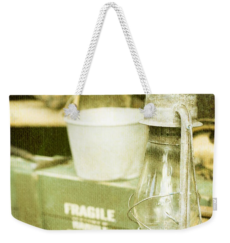 Aluminum Weekender Tote Bag featuring the photograph Vintage Lamp by Tom Gowanlock