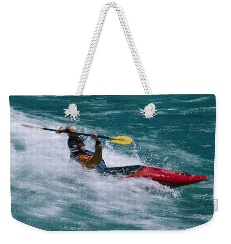 Boats Weekender Tote Bag featuring the photograph Whitewater Kayaker Surfing A Standing by Skip Brown