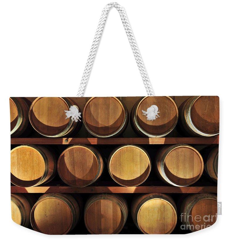 Barrels Weekender Tote Bag featuring the photograph Wine Barrels by Elena Elisseeva