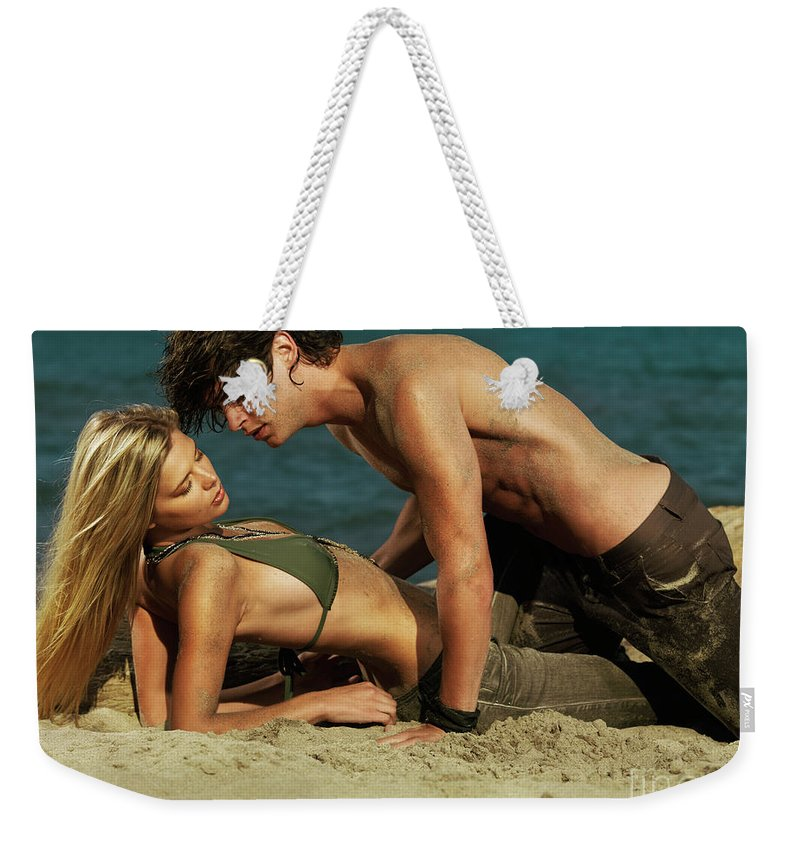Love Weekender Tote Bag featuring the photograph Young Couple On The Beach by Oleksiy Maksymenko
