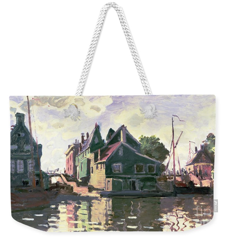 Town; Impressionist; Landscape; River Zaan; Sunlight; Boat; Boats; Canal; The Netherlands; Holland; Reflections Weekender Tote Bag featuring the painting Zaandam by Claude Monet