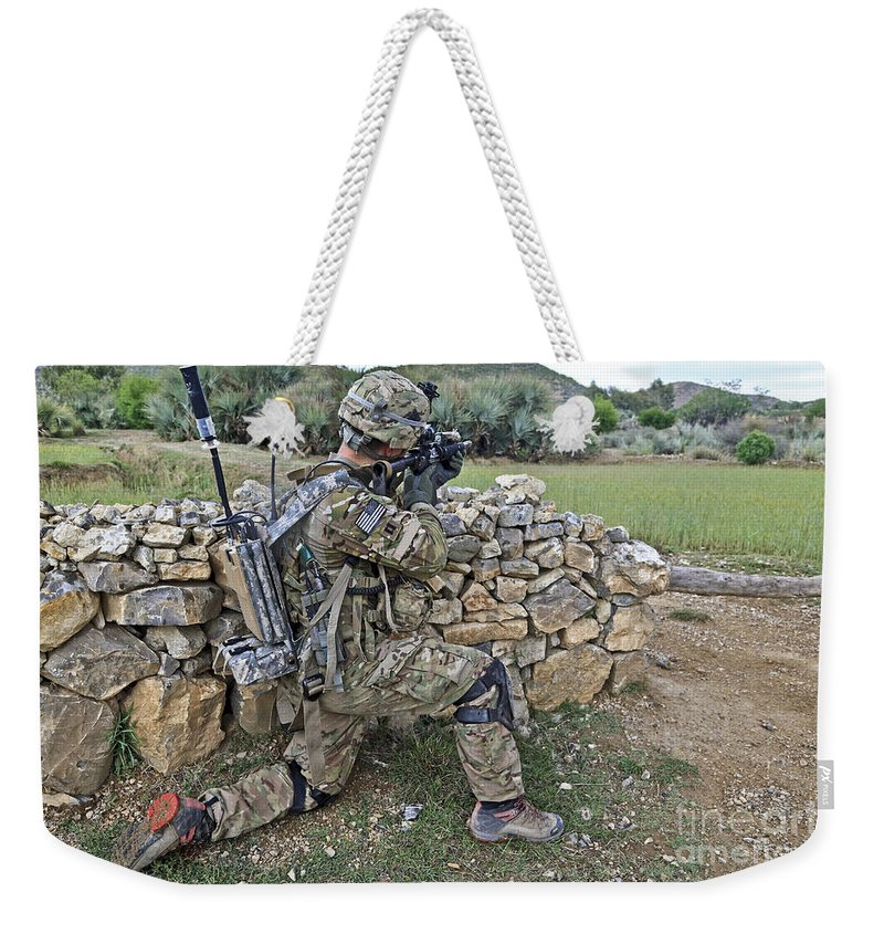 Military Weekender Tote Bag featuring the photograph U.s. Army Soldier Provides Security by Stocktrek Images