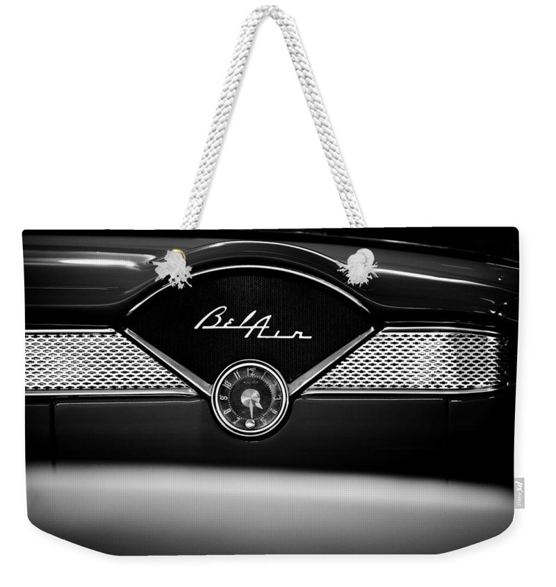 1955 Bel Air Weekender Tote Bag featuring the photograph 1955 Chevy Bel Air Glow Compartment In Black And White by Sebastian Musial