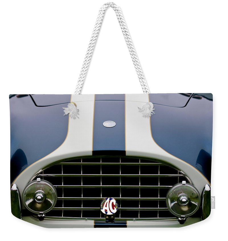 1960 Ac Ace Roadster Weekender Tote Bag featuring the photograph 1960 Ac Ace Roadster Grille Emblem by Jill Reger