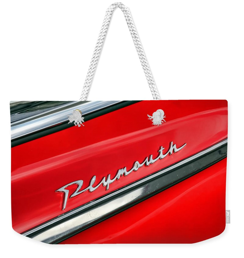 1962 Weekender Tote Bag featuring the photograph 1962 Plymouth Belvedere Drivers Door Emblem by Gordon Dean II