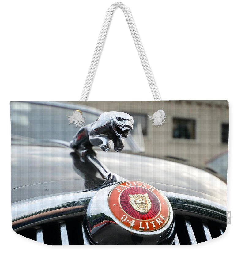 Jaguar Grill Weekender Tote Bag featuring the photograph 1963 Jaguar Emblem by Paul Ward