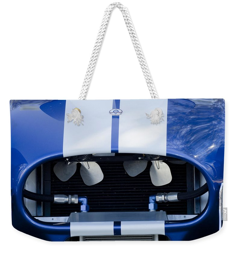 1965 Cobra Sc Weekender Tote Bag featuring the photograph 1965 Cobra Sc Grille by Jill Reger