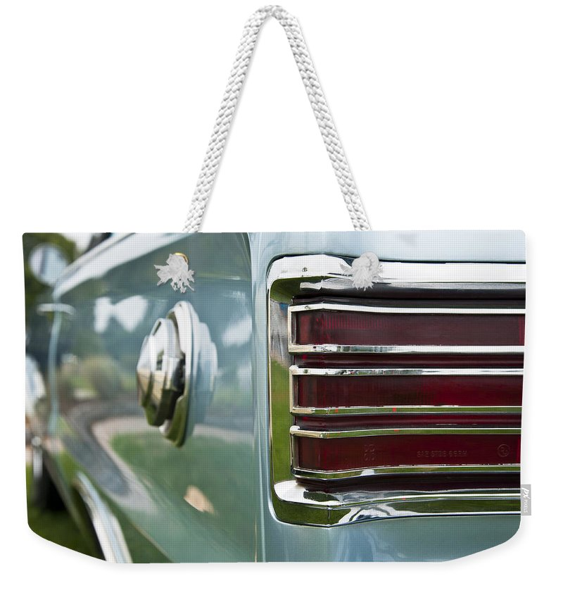 1966 Plymouth Satellite Tail Light Weekender Tote Bag featuring the photograph 1966 Plymouth Satellite Tail Light by Glenn Gordon
