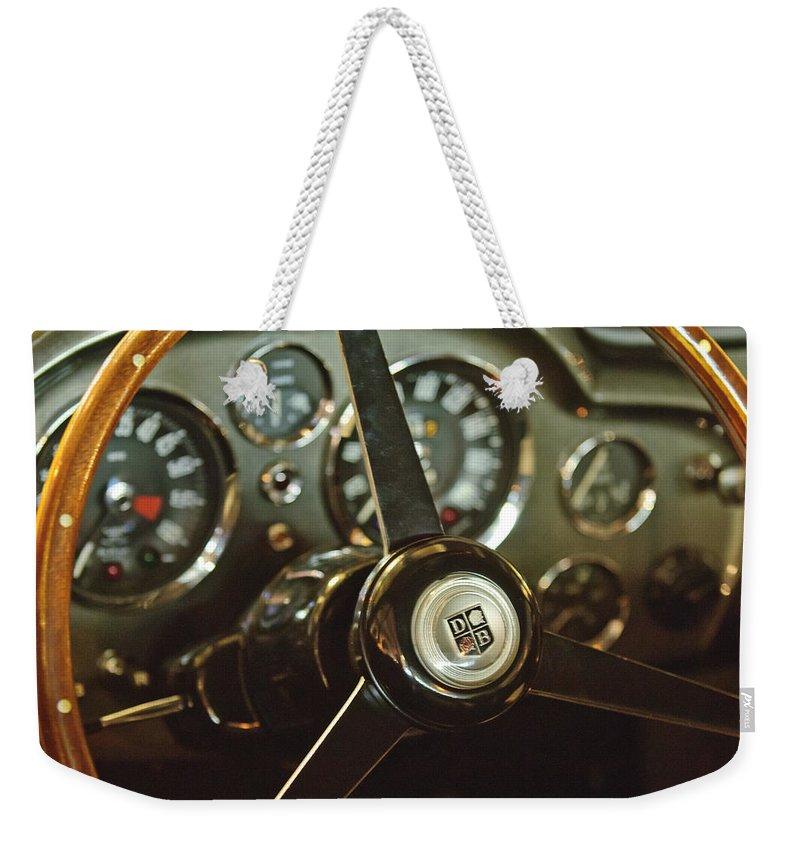 1968 Aston Martin Db6 Weekender Tote Bag featuring the photograph 1968 Aston Martin Db6 Steering Wheel Emblem by Jill Reger