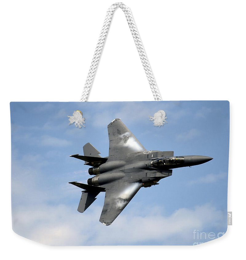 Air Force Weekender Tote Bag featuring the photograph An F-15e Strike Eagle Soars by Stocktrek Images
