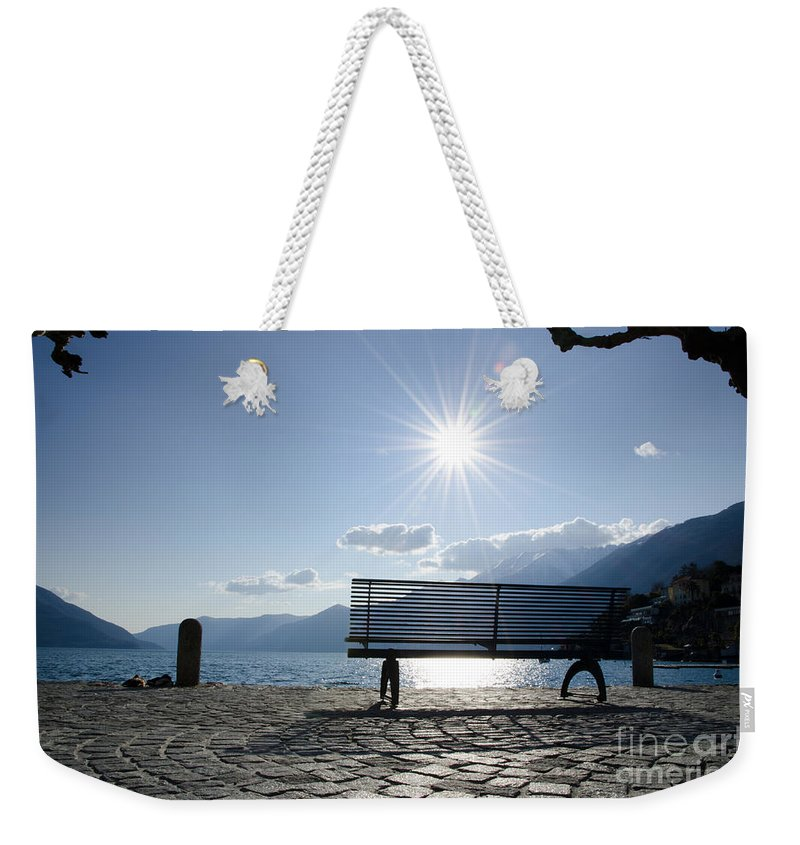 Bench Weekender Tote Bag featuring the photograph Bench In Backlight by Mats Silvan