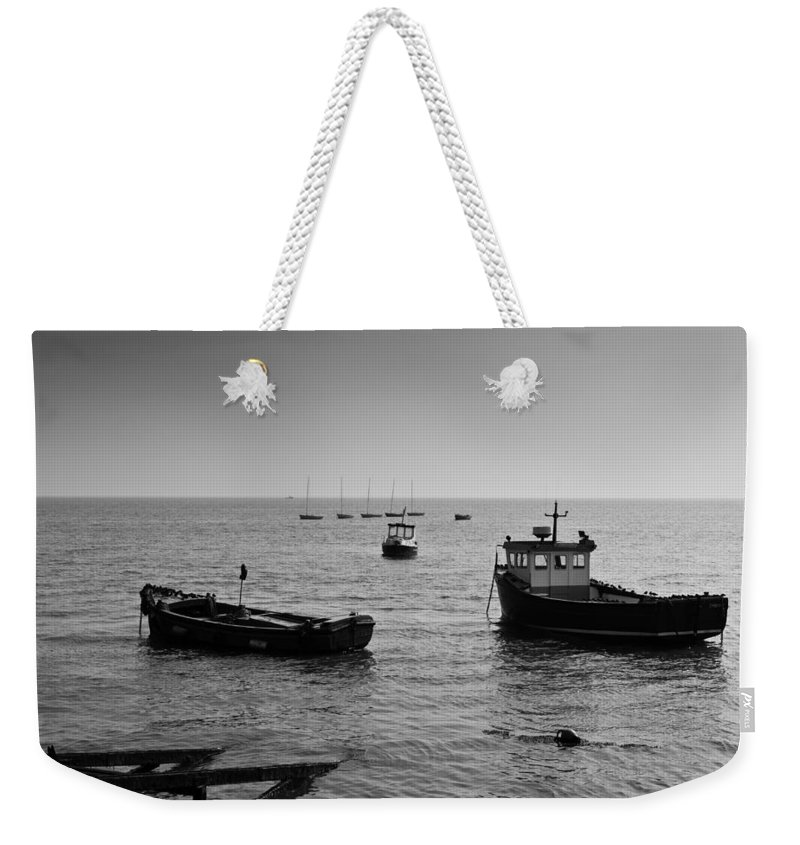 Dinghie Weekender Tote Bag featuring the photograph Boats Moored Off Of Leigh Essex by David Pyatt