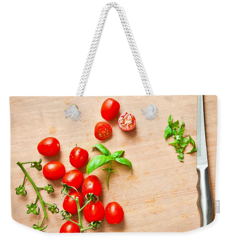 Aromatic Weekender Tote Bag featuring the photograph Cherry Tomatoes by Tom Gowanlock