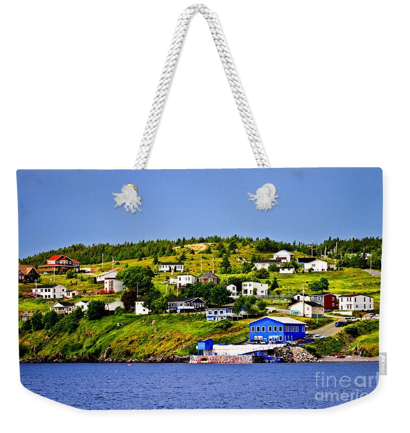 Fishing Weekender Tote Bag featuring the photograph Fishing Village In Newfoundland by Elena Elisseeva