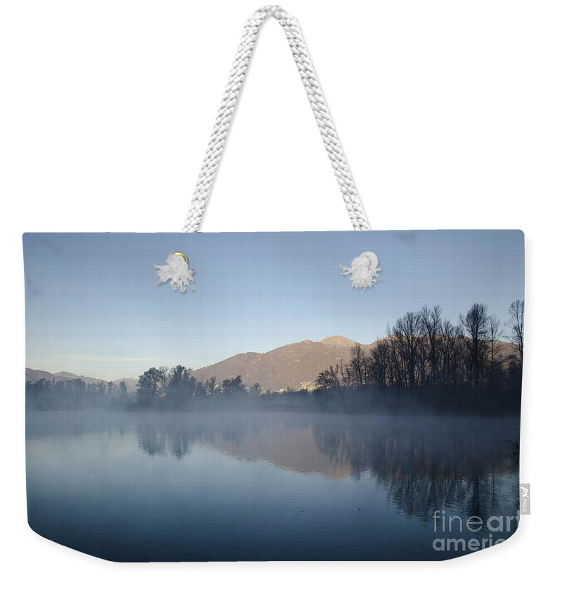 Lake Weekender Tote Bag featuring the photograph Foggy Lake by Mats Silvan
